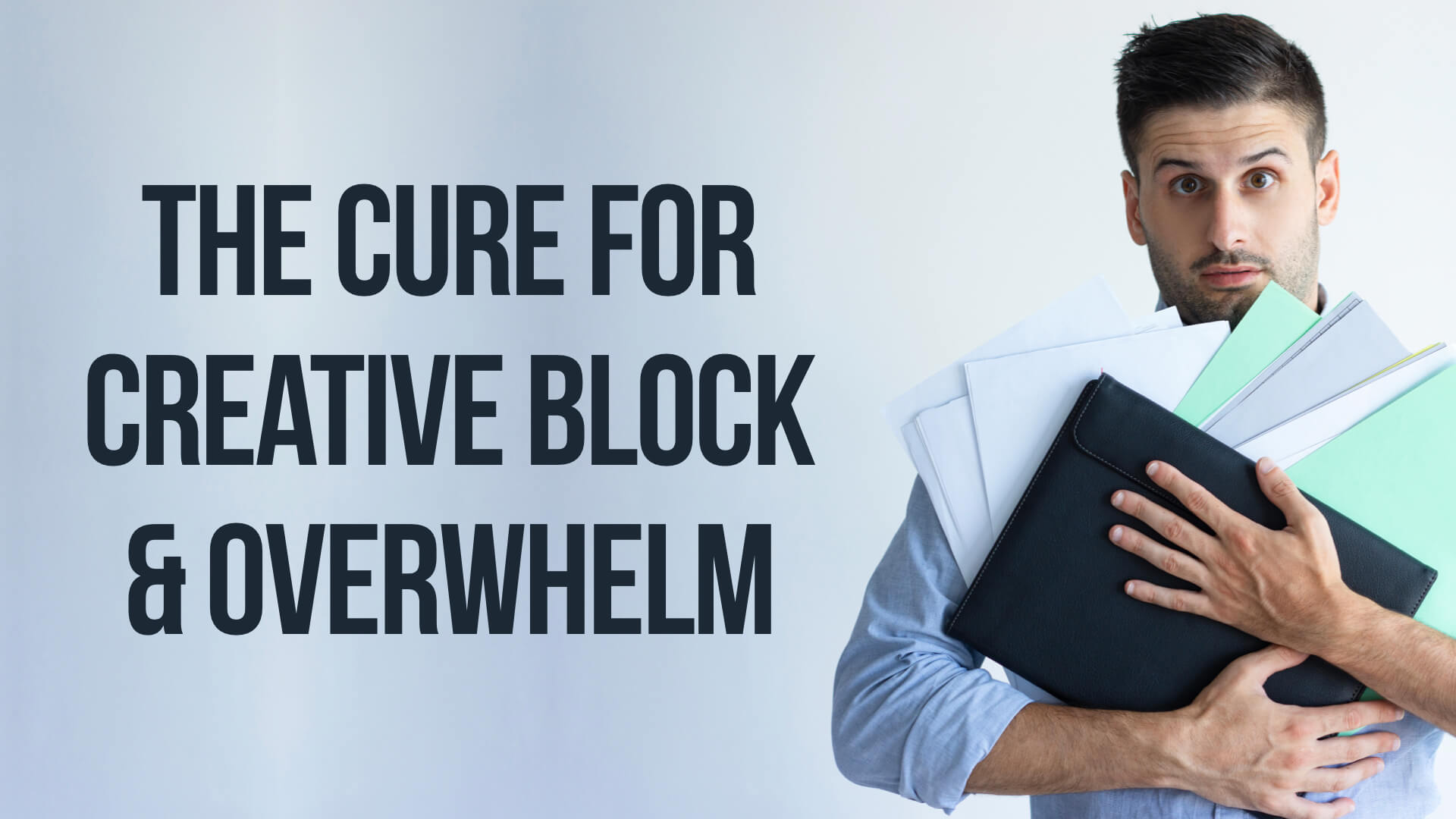 Man suffering from creative block holding a stack of papers